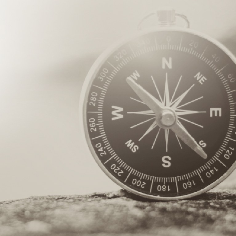 Black and white photo of a compass