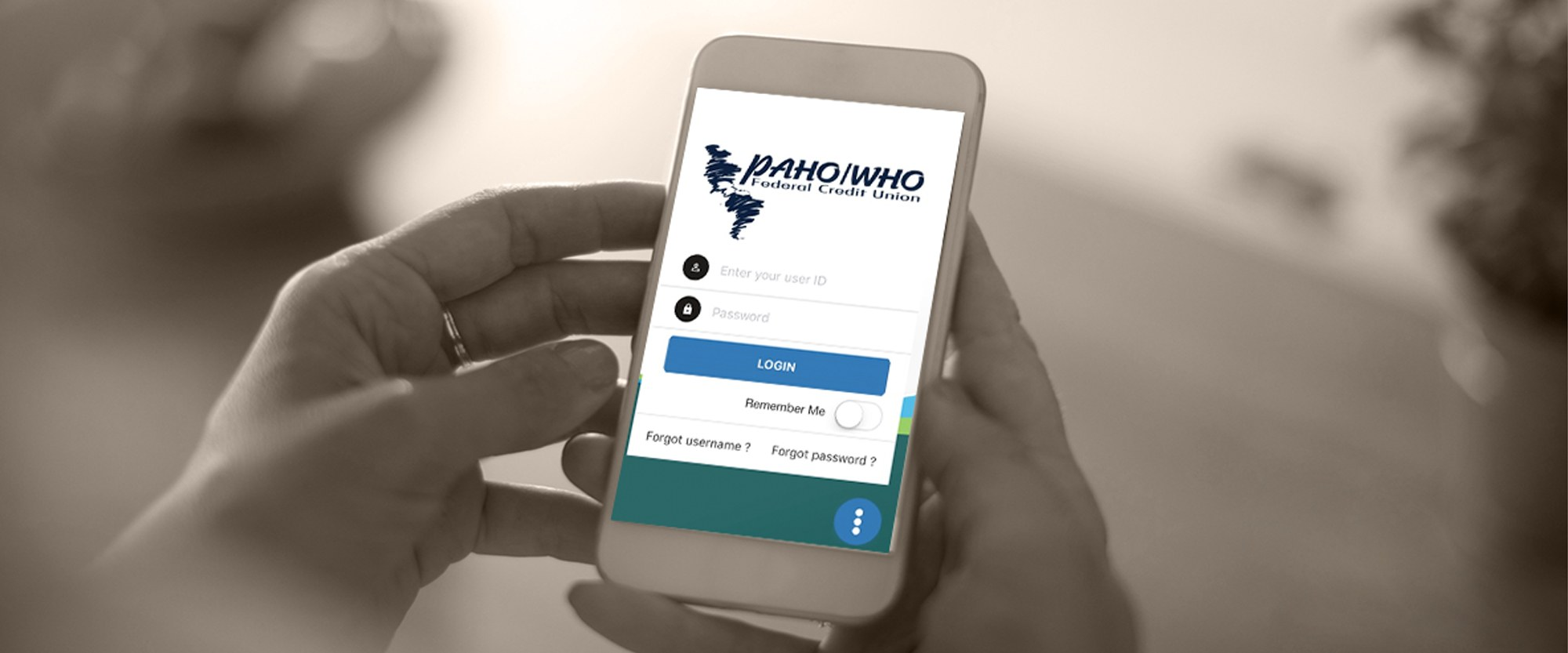 Person logging into PAHO/WHO Credit Union on mobile device
